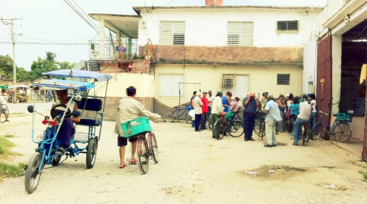 Cubans waiting in a queue to buy goods in CUP, Santa Clara, Cuba.