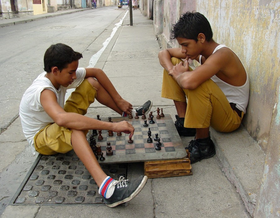 Boys Playing Chess on the Street - Santiago de Cuba - Cuba. Photo by Adam Jones.